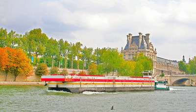 Barge making its way down the river, Musée du Louvre in the background.