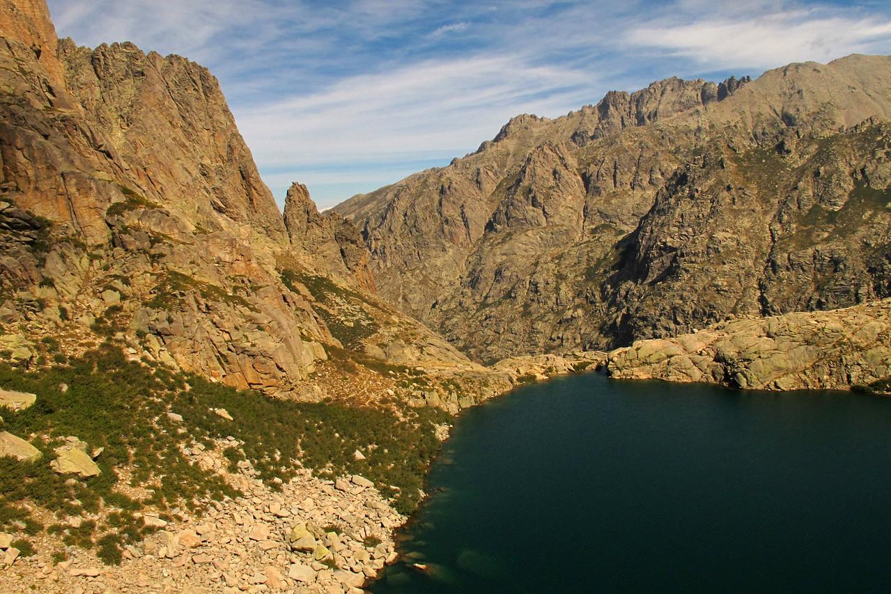 Climbing the route Symphonie d'automne at the Lac de Capitello