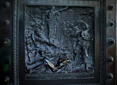One of the panels on the huge doors. The bas reliefs on the bronze doors are by Henri de Triqueti and represent the Ten Commandments.