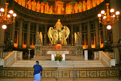 At the rear of the church, above the high altar, stands a statue by Charles Marochetti depicting St Mary Magdalene being carried up to heaven by two angels.