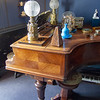 Ravel house composing room. The glass covered ship behind the blue vase can be lifted to expose a little crank that makes the ship go to and fro in the waves.