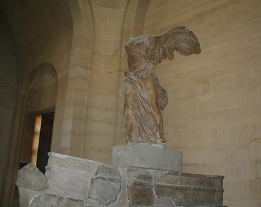 The Winged Victory of Samothrace, also called Nike of Samothrace - is a marble sculpture of the Greek goddess Nike (Victory), discovered in April 1863 on the island of Samothrace by the French consul and amateur archaeologist Charles Champoiseau. The statue was sent to Paris the same year, and since 1884 has dominated the Daru staircase displayed in the Louvre, while a plaster replica stands in the museum at the original location of the Sanctuary of the Great Gods on Samothrace. Ceramic evidence discovered in recent excavations has revealed that the pedestal was set up about 200 BC.