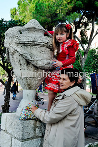 Nice, France, Public Events, Carnival Parade, Mother and Daughter, Dressed up in Costume, Watching Parade in Crowd, from Public Sculpture in Park