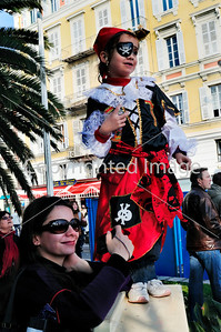 Nice, France, Public Events, Carnival Parade, Mother with Daughter in Pirate Costume, Watching Parade in Crowd