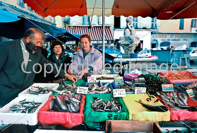 Nice, France, Shopping, Algerian-orign Man in Fish Store at Public Market, Cours Saleya, Woman Fish Mongerer