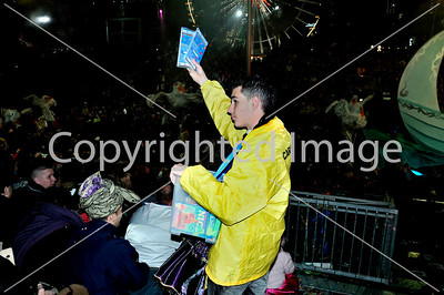 Nice, France, Public Events, Carnival Parade, Male Teen Selling Event DVD's to Crowd