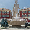 The Apollo statue that crowns the fountain at Place Massena