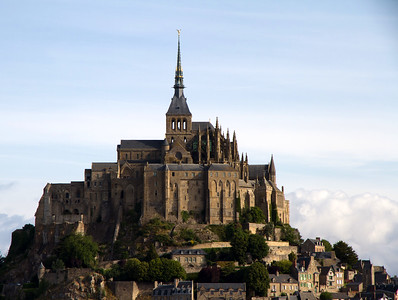 The Abbey du Mont St. Michel, built sometime in the 8th Century.  http://en.wikipedia.org/wiki/Mont_Saint-Michel