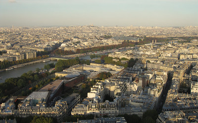 Mimicking a view from Mt.Kinabalu, the Eiffel Tower stretches its shadow across Paris, while the Sacre Coeur rises in the distance.