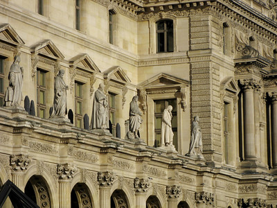 Characters stand watch over Louvre's plaza