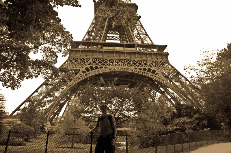 Sepia toned photo of me at the base of the Eiffle tower