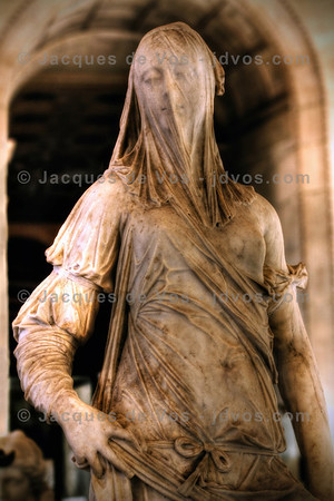 Veiled Woman (second quarter of the 18th century)<br /> <br /> Standing in the Louvre in Paris and only about 138cm tall... The identity of the sculptor is unknown, as is the identity of the subject: a beautiful woman with her face veiled, and her hands the only exposed portion of her body, as she stands lost in thought.