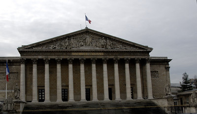 The Palais Bourbon, a palace located on the left bank of the Seine, across from the Place de la Concorde, Paris (which is on the right bank), is the seat of the French National Assembly, the lower legislative chamber of the French government.  The palace was originally built for Louis XIV's legitimized daughter the duchesse de Bourbon, to a design by an Italian architect Giardini, approved by Jules Hardouin-Mansart. Giardini oversaw the actual construction from 1722 until his death in 1724, after which Jacques Gabriel took over, assisted by L'Assurance and other designers, until its completion in 1728.