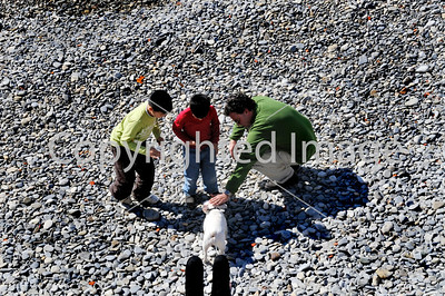 Nice, France - Beach Scene, French Family Petting Dog, near Mediterannean Sea, View From Above,
