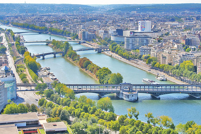 View of the Seine River and it's beautiful bridges - closest is Bir-Hakeim Bridge, next Grenelle Bridge, gurtherest is Mirabeau bridge.