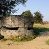 "<div style=""text-align: left;"">The Memorial Site has the remains of several concrete bunkers and craters from the 1915/16 and 1917 battles. This large bunker in the centre of the site is preserved almost as it was found at the end of the war. It was used by both German and British Armies.</div>"