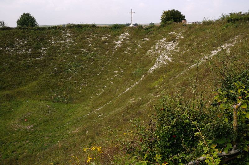 "<div style=""text-align: left;"">The Lochnagar Crater was formed at 7.28am on Saturday, 1st July 1916 - the first day of the Battle of the Somme. It was created by the detonation of a huge mine placed beneath the German front lines and its aim was to destroy a formidable strongpoint called 'Schwaben Höhe'. Close to a British trench called Lochnagar Street tunnellers dug a shaft down about 90 feet deep into the chalk. They then excavated some 300 yards towards the German lines, placing 60,000 lbs (27 tons) of ammonal explosive in two large adjacent underground chambers 60 feet apart. Two minutes before the attack began, the mine was exploded, leaving the massive crater that we see today.</div>"