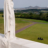 """<div style=""""text-align: left;"""">The mourning figure of """"Mother Canada"""" on the Canadian National Vimy Memorial. She stands on the objective for the Canadian Corps, successfully won at the Battle of Vimy Ridge. Winning this high ground gave the Allies a view across the German rear areas on the Lens-Douai plain. The Double Crassier slag heaps at Loos-en-Gohelle can be seen on the horizon.</div>"""