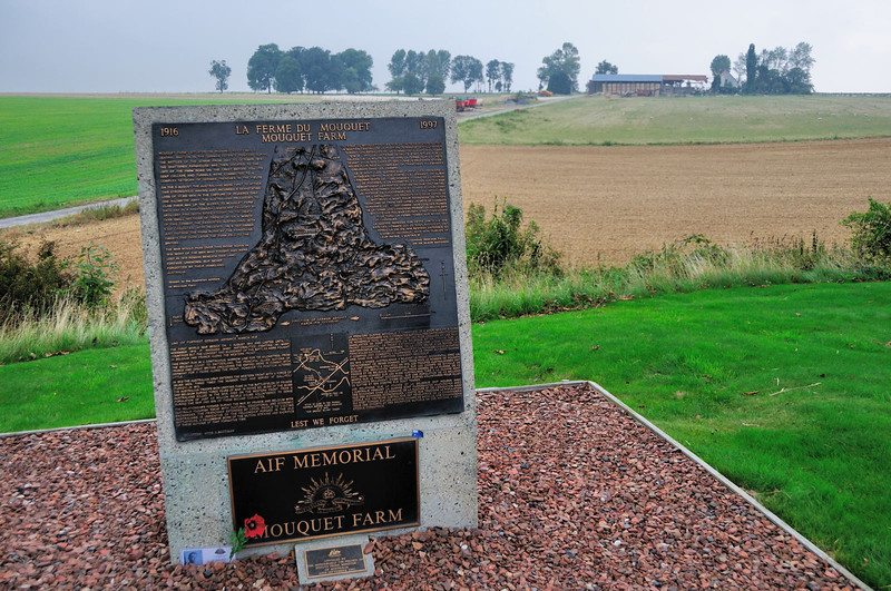 "<div style=""text-align: left;"">Mouquet Farm was the site of nine separate attacks by three Australian divisions between 8 August and 3 September 1916. The farm stood in a dominating position on a ridge that extended north-west from the ruined, and much fought over, village of Pozières. Although the farm buildings themselves were reduced to rubble, strong stone cellars remained below ground which were incorporated into the German defences. The attacks mounted against Mouquet Farm cost the 1st, 2nd and 4th Australian Divisions over 11,000 casualties, and not one succeeded in capturing and holding it. The British advance eventually bypassed Mouquet Farm leaving it an isolated outpost. It fell, inevitably, on 27 September 1916.  The original farm was to the left of the road seen leading up to the current farm, in this view.</div>"