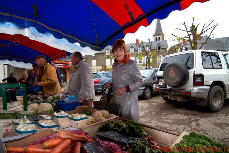 Carol Gardyne buying fresh vegetables