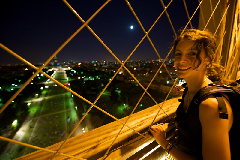 The view from level one of the Eiffel Tower with moonlight.