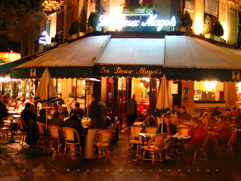 Cafe Les Deux Magots at Night - This famous cafe on the Left Bank of the Seine, Les Deux Magots is popular with both tourists and Parisians, It has a long history as a meeting place for famous writers and philosophers. Deux Magots was once a favorite spot for existentialist writers Jean-Paul Sartre and Simone de Bouvoir, and a favorite of Hemmingway and Picasso where he reportedly created cubism - JohnBrody.com
