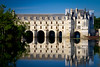 Chateau Chenonceau reflected in the still waters of the River Cher.