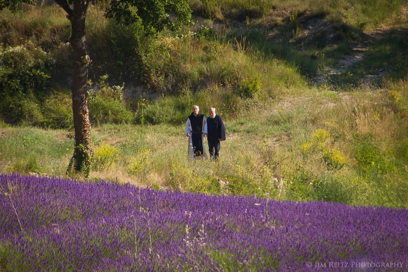 Two of the monks from the Abbey take a stroll past their lavender fields.