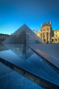 View of the Louvre main entrance pyramid, early morning.