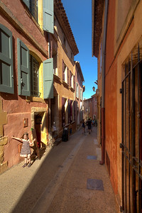 Colorful buildings and narrow streets in Roussillon.