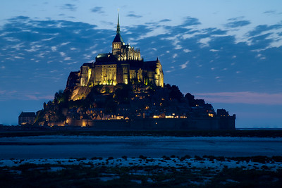 After sunset, the abby of Mont St. Michel is brilliantly illuminated.