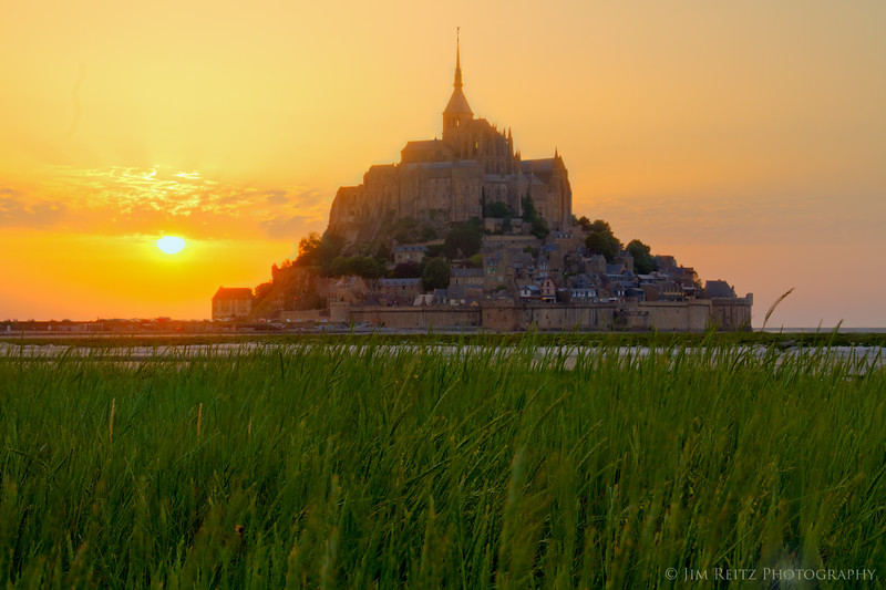 Sunset behind Mont St. Michel. View from the tidal marshes.