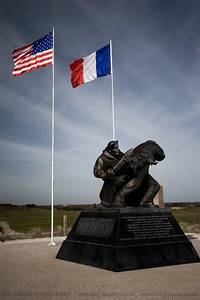 "US Naval Memorial, Utah Beach, Normandy, France.  ""To the officers and sailors of the United States Navy whose competence, courage and sacrifice enabled Operation Overlord, the greatest amphibious invasion in history.  Their selfless cause was the destroy tyranny and restore freedom and self determination.  The fallen will never be forgotten; the veteran will ever be honored.  In grateful appreciation, the Naval Order of the United States."""