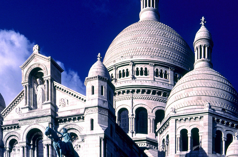 Domes and upper entrace facade of the Sacre Coeur Cathedral, Montmartre, Paris.