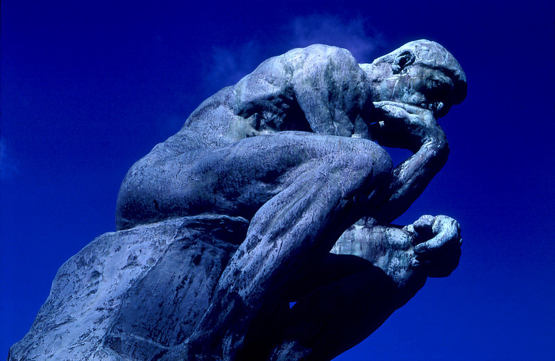 """The Thinker"" by Auguste Rodin. In the gardens of the Musee Rodin, Paris."