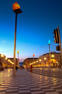 Place Massena - Nice's main public square - lights up at night, including these strange statues of sitting men atop poles.