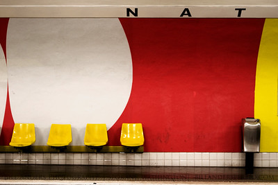 Four Yellow Seats.  Assemblee Nationale Metro Station, Paris, France.
