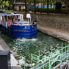A barge making it through the locks along the Canal Saint-Martin