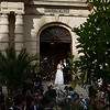 A bride and group leaving the Hôtel de Ville