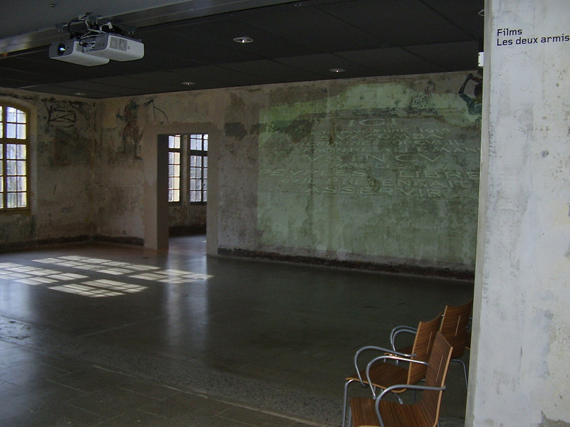 Inside one of the barracks at Royallieu, the Nazi deportation camp at Compiègne. A film is being projected on the wall.