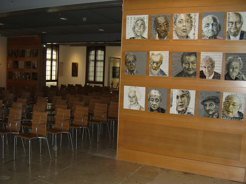 Conference room at the museum at Royallieu with drawing of the victims.