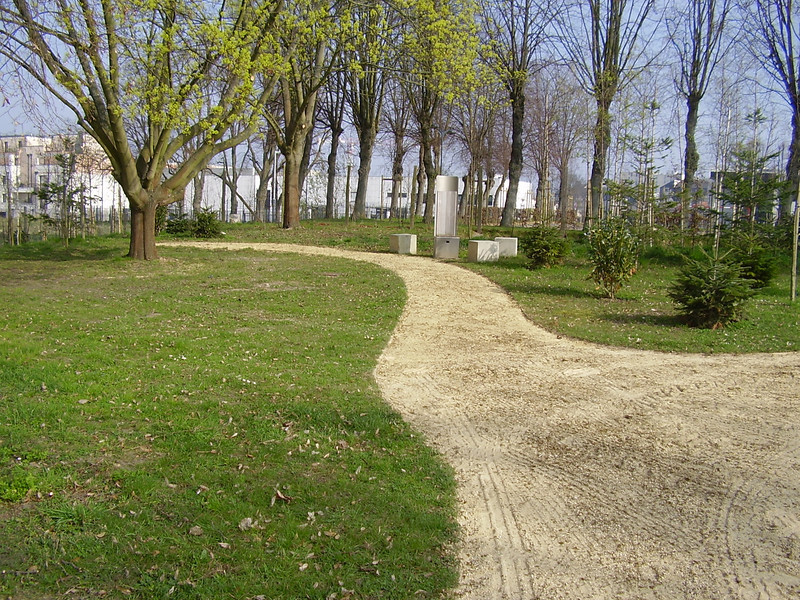"The grounds of Royallieu, the path leading to a ""talking chair."" These exhibits have motion detectors which start recordings of stories by survivors."