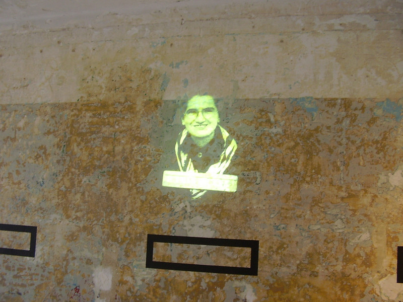 Images of victims projected on the barracks walls at Royallieu.