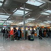 Passengers checking in at airport terminal in Frankfurt, Germany.