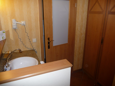 Immediately upon walking in the door you are at the only sink and the toilet/shower room as well as the closet.
