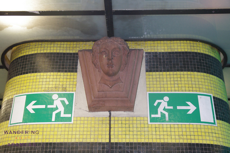 Just a gargoyle-ish head, watching over the U-Bahn station.