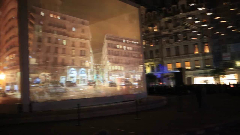 Movie projected onto canvas screen surrounding a monument for the Christmas Festival of Lights in Lyon, France.