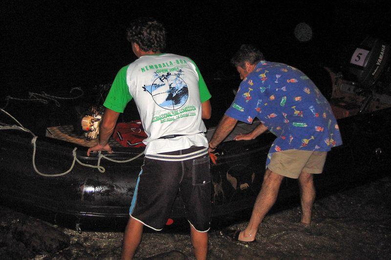 Remy and Douglas haul the zodiac onto shore (Moorea - Topside)