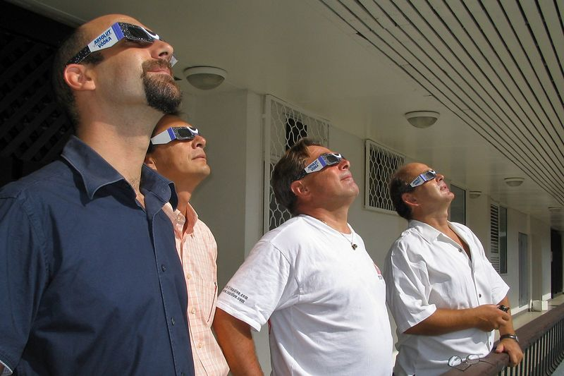 Manu, John, Lucien, and Bernhardt check out the eclipse