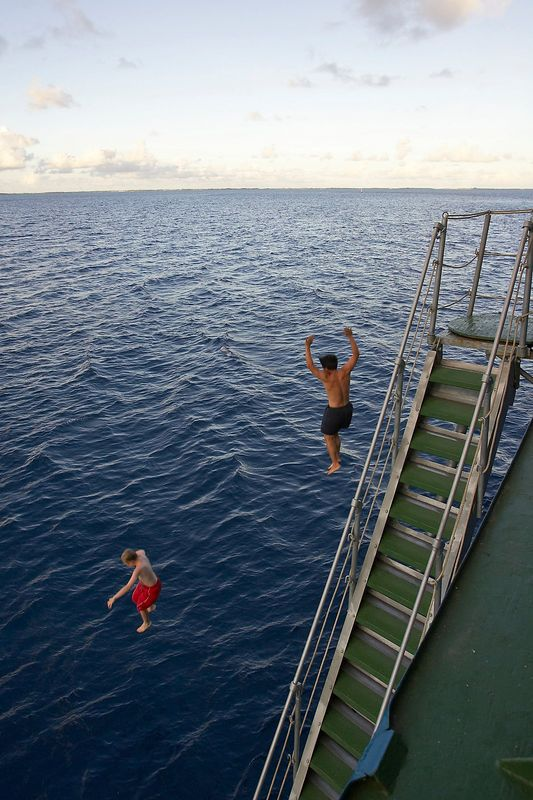 Timoty McDowell and Eric Cheng jumping off of the gangway (Boat - Akademik Shokalskiy)